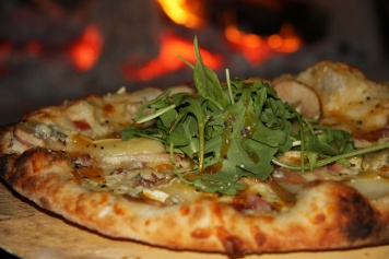 Figlio Pear and Brie Pizza garnished with arugula