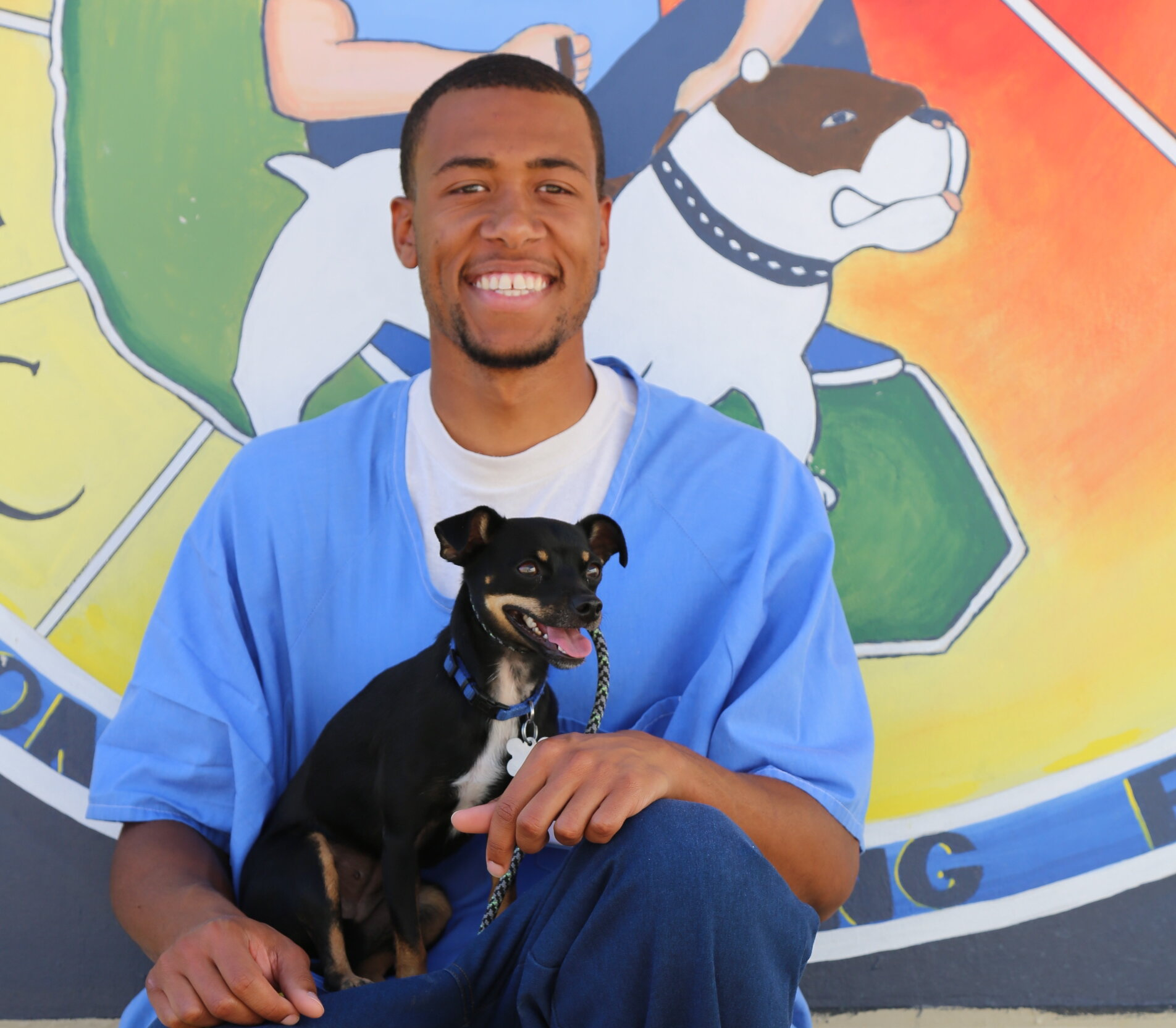 Troy McDaniel with chihuahua-doberman pinscher mix, Chi Chi.